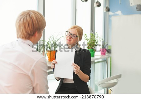 woman showing blank paper - stock photo