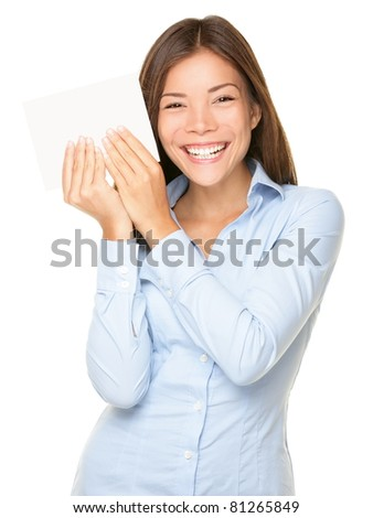 Woman showing blank paper sign cute smiling isolated on white background - stock photo