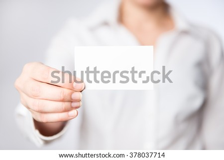 Woman showing business card