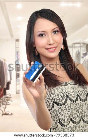 woman showing  credit card for shopping