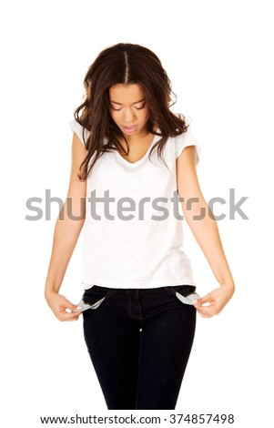 Woman showing empty pockets. - stock photo