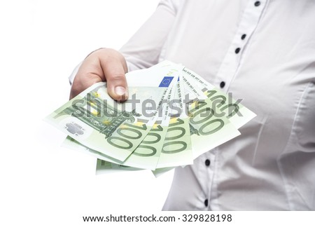 Woman showing euro money isolated on white background