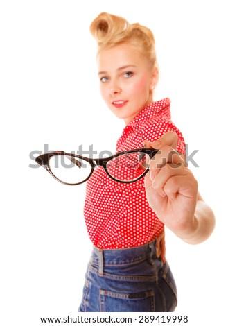 Woman showing eyewear. Beautiful girl retro hairstyle holding glasses studio shot isolated on white - stock photo