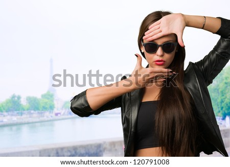Woman Showing Finger Frame in paris - stock photo