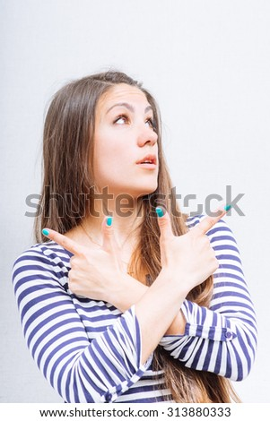 Woman showing forefinger in different directions fingers