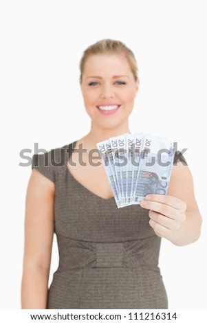 Woman showing her euro banknotes against white background
