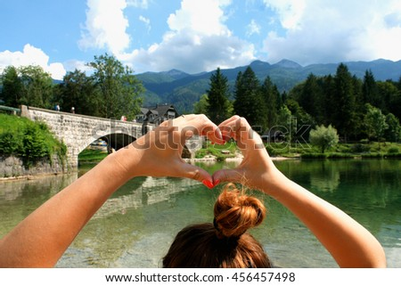 woman showing her love in nature and lake. - stock photo