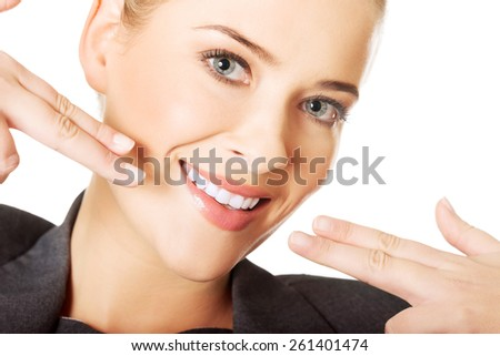 Woman showing her perfect white teeth. - stock photo