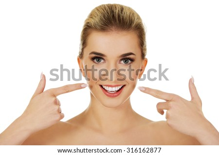 Woman showing her white teeth, isolated on white
