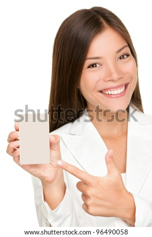 Woman showing holding blank sign. Replace with smart phone, mobile phone or copy. Smiling happy young business woman. Mixed race Caucasian / Chinese Asian female model isolated on white background. - stock photo
