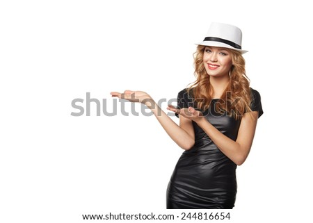 Woman showing / holding on the palm blank copy space over white background - stock photo