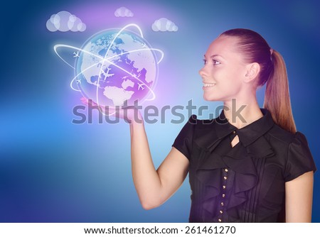 woman showing holding on world map globe - stock photo