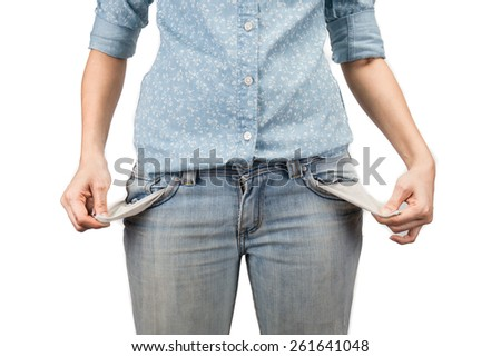 woman showing she has no money by turning out her pockets - stock photo