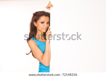Woman showing sign. Cute casual young beautiful woman showing blank white sign isolated on white background waist up. Pretty, lovely and fresh asian caucasian female model. - stock photo