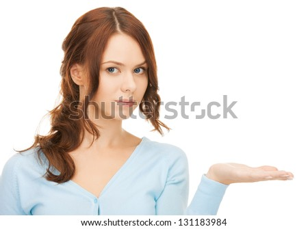 woman showing something on the palm of her hand