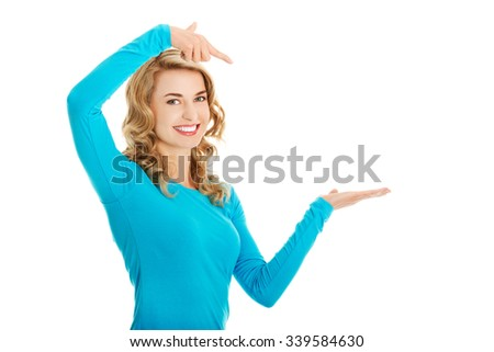 Woman showing something or copyspase for product or sign text - stock photo