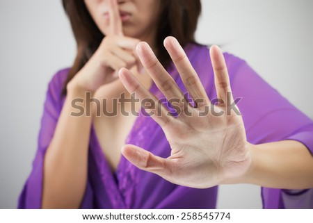 Woman showing stop hand - stock photo