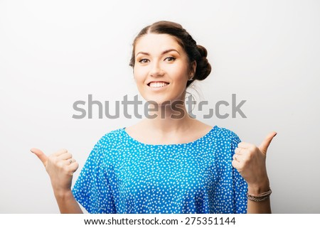 woman showing thumbs up - stock photo