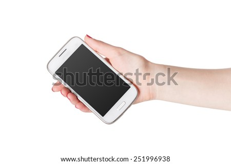 Woman showing white smart phone in hand. Isolated on white background with a pure black screen gradient. - stock photo