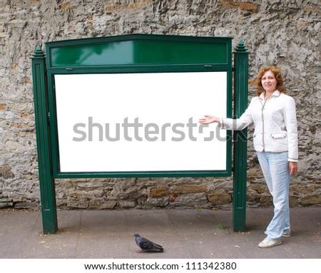 Woman shows a blank billboard - stock photo