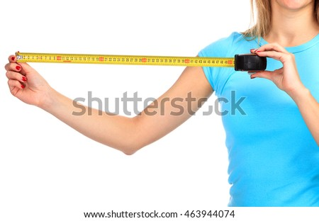 Woman shows a yellow measure tape, isolated on a white background