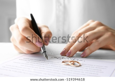 Marriage contract stock images royalty free images vectors woman signing marriage contract closeup thecheapjerseys Images