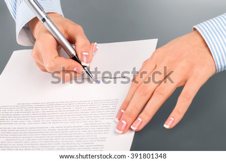 Woman signing rent contract. Female employee signs rent contract. Beneficial for both sides. Simple clear agreement. - stock photo