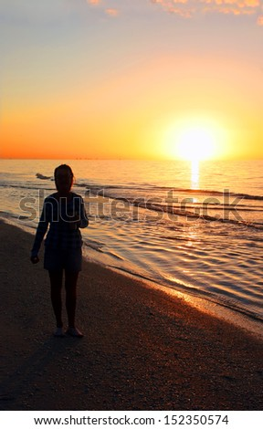 Woman Silhouette at Sunrise Sanibel Florida Beach - stock photo