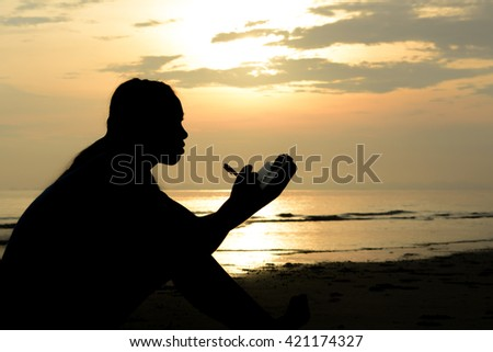 Woman silhouette note business plan. Background sunset over the sea