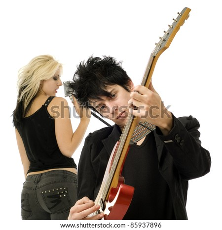 Woman singer and male guitarist close up in garage band isolated on white - stock photo