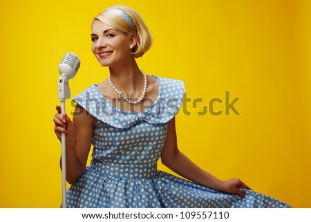 Woman singer in blue dress - stock photo