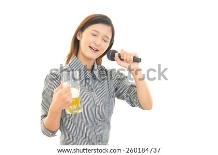 Woman Singing Karaoke with Beer