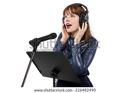 woman singing or reading a script for voice over - stock photo