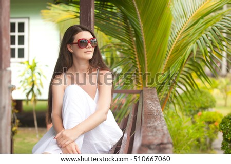 woman sit in tropical resort