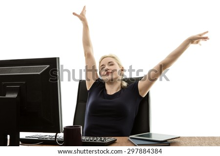 woman siting at her desk resting in her chair - stock photo