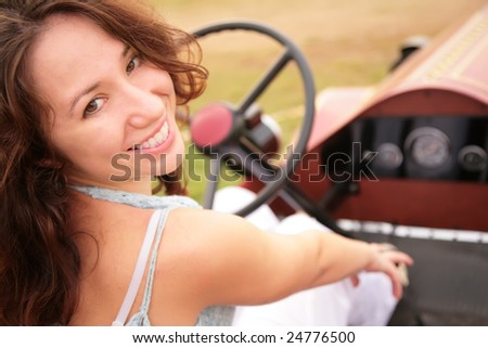 Woman sits having turned back in salon of the ancient car - stock photo