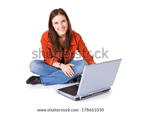 Woman Sits On Floor With Computer and Looks At Camera