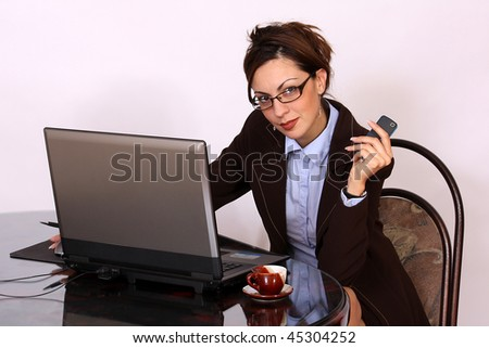 Woman sitting and working on lap top computer