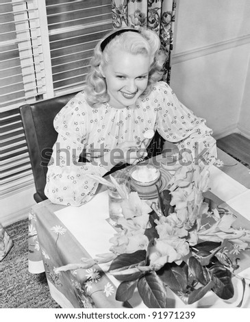 Woman sitting at a breakfast table