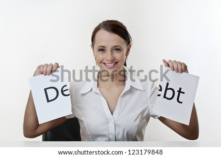 woman sitting at a desk getting rid of debt - stock photo