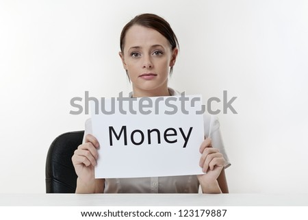 woman sitting at a desk worried about money problems