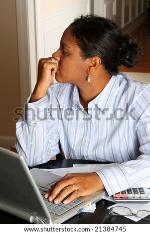 Woman sitting at the computer in her home