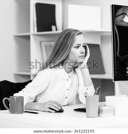 Woman sitting at the desk  with computer