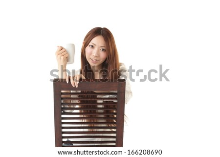 Woman sitting in a chair - stock photo