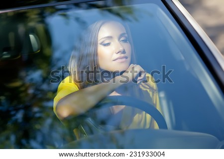 woman sitting in car, Happy girl driving automobile, outdoors summer portrait