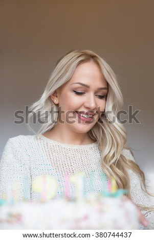 Woman sitting in front of birthday cake