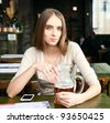 woman sitting in the cafe with a glass of beer - stock photo