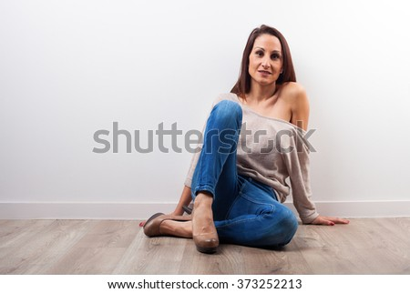 woman sitting on a house wooden floor