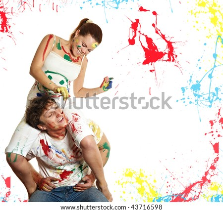 woman sitting on a man and draws a brush