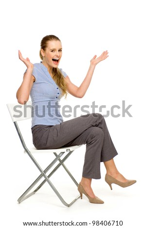 Woman sitting on chair gesturing - stock photo